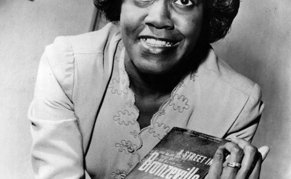 Gwendolyn Brooks poses with her first book of poems, A Street in Bronzeville.