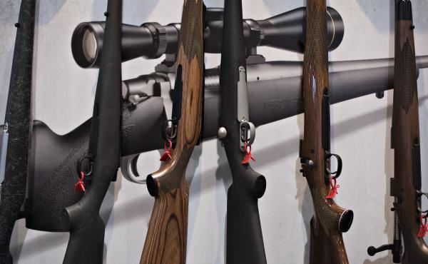 Bolt action rifles are displayed in the Remington Arms Company booth at the National Rifle Association annual meeting in Nashville in 2015.