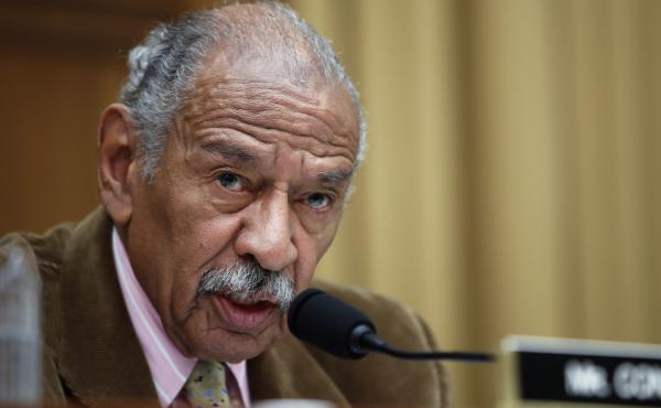 Rep. John Conyers, D-Mich., speaks during a House Judiciary hearing in April. Documents show that Conyers settled a wrongful dismissal complaint with a former female employee two years ago.