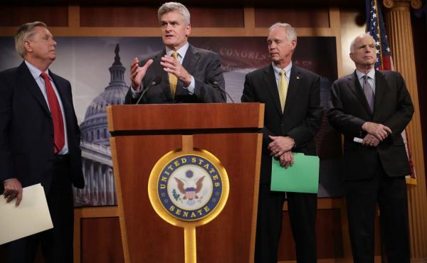 Sen. Lindsey Graham (from left), Sen. Bill Cassidy, Sen. Ron Johnson and Sen. John McCain, all Republicans, announced Thursday that they would not vote for a so-called skinny repeal of the Affordable Care Act without assurances from the House that the bil