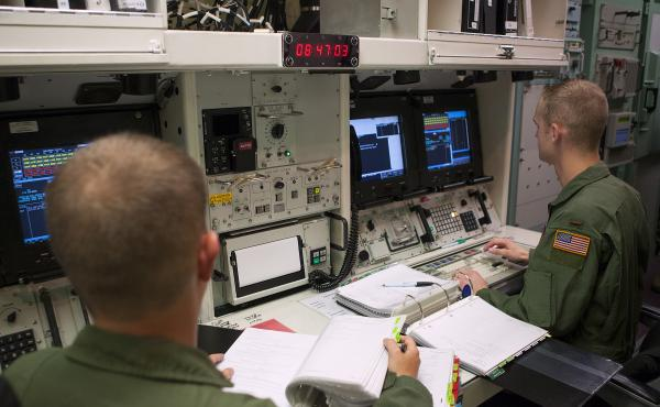 Members of the 320th Missile Squadron missile combat crew work through a scenario in the 90th Operations Support Squadron's Missile Procedure Trainer on F.E. Warren Air Force Base, Wyo., in June 2014. The MPT is a simulator that allows missile crews to pr