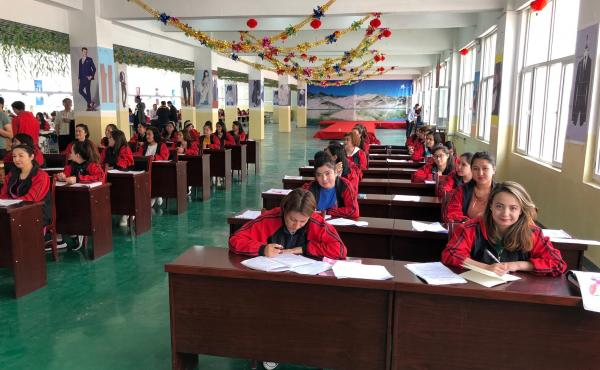 "Uighur detainees at a detention facility in Kashgar take vocational classes. All the detainees in this class admitted to having been ""infected with extremist thoughts."""