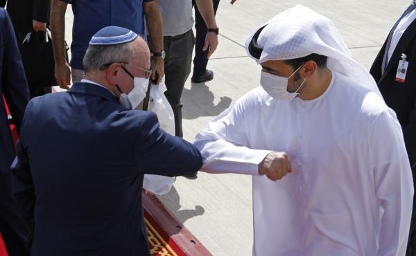 Israeli national security adviser Meir Ben-Shabbat (left) elbow-bumps with an Emirati official as he leaves Abu Dhabi, United Arab Emirates, Tuesday.