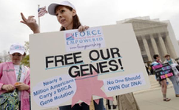 Lisa Schlager of Chevy Chase, Md., demonstrates outside of the Supreme Court as arguments were made in a case seeking to determine whether the BRCA breast cancer genes can be patented. The court ruled in 2013 that individual genes can't be patented.