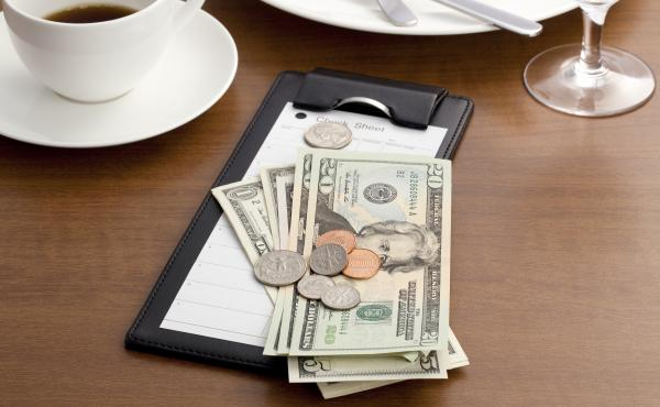 A new rule proposed by the Labor Department would allow employers to require waitstaff and others to share their tips with kitchen staff. But labor advocates say it could allow bosses to take advantage of their workers.