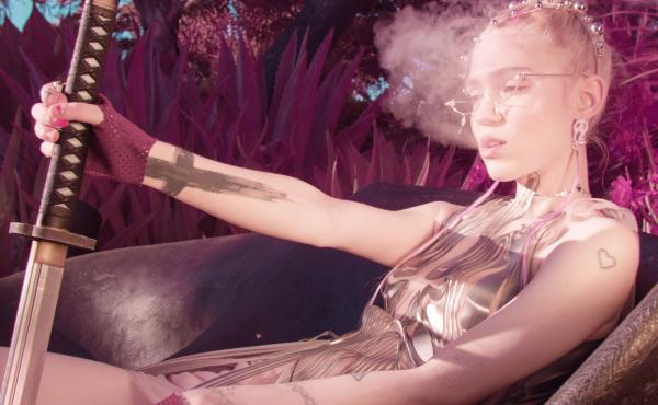 Grimes' fifth album, Miss Anthropocene, pushes the pleasure buttons of mainstream pop while also appearing to critique it.