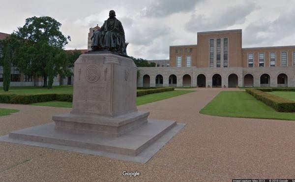 """Rice University says many undergraduate students from families with incomes up to $200,000 """"will no longer be required to take out loans."""" Here, a statue of the school's founder, William Marsh Rice, is seen on its campus in Houston."""