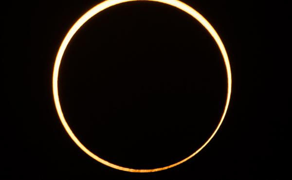 "The moon moves in front of the sun in a rare ""ring of fire"" annular solar eclipse, as seen in the sky over Singapore on Thursday."