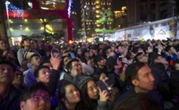 People watch fireworks in Taipei, Taiwan.