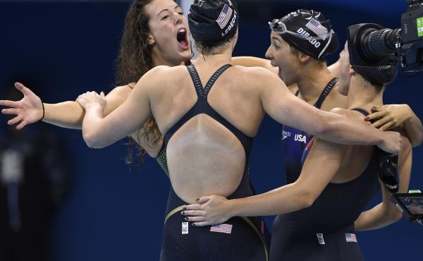 """Allison Schmitt, Katie Ledecky, Madeline """"Maya"""" Dirado and Leah Smith celebrate after they won the Women's 4x200m Freestyle Relay final for the U.S. Wednesday night at the Rio 2016 Olympic Games."""