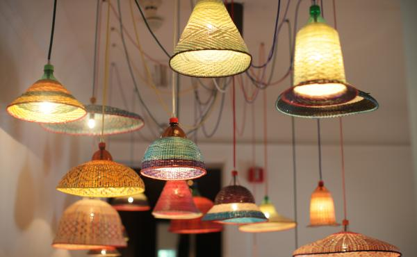 Spanish designer Alvaro Catalan de Ocon taught Colombian artisans how to recycle plastic bottles into art using traditional weaving techniques. The sale of these lamps helps support local communities.