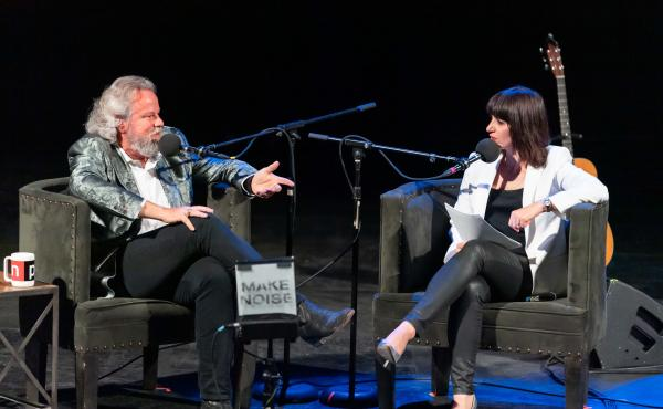 Host Ophira Eisenberg with Robert Earl Keen on Ask Me Another at the Aztec Theatre in San Antonio, Texas.