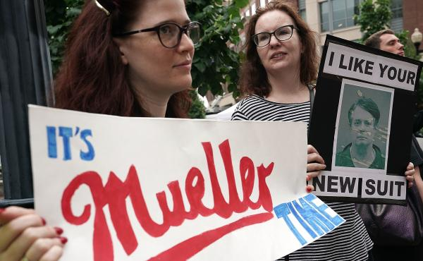 Activists protest outside the federal courthouse in Alexandria, Va., on July 31, 2018, the first day of the trial of former Trump campaign chairman Paul Manafort.