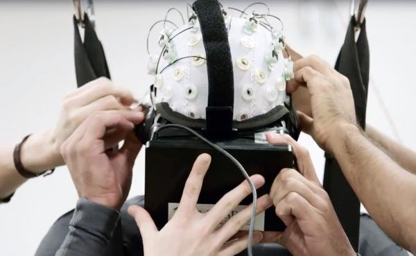"Scientists with the international scientific collaboration known as the ""Walk Again Project"" use noninvasive brain-machine interfaces in their efforts to reawaken damaged fibers in the spinal cord."
