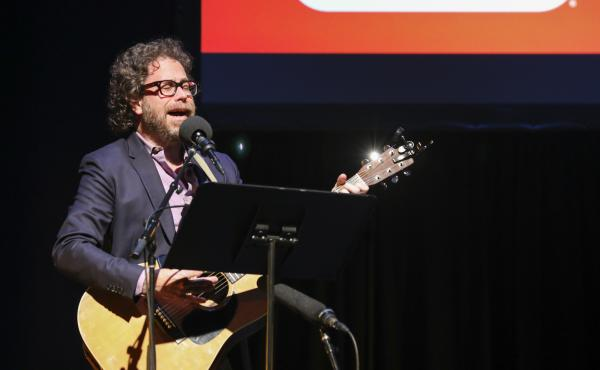 Ask Me Another's house musician Jonathan Coulton leads a music parody game at TPAC's Polk Theater in Nashville, Tennessee.