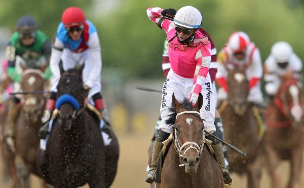 Jockey Flavien Prat, #6, riding Rombauer, celebrates as he wins the 146th running of the Preakness Stakes at Pimlico Race Course on Saturday in Baltimore.