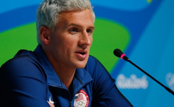 Ryan Lochte of the United States attends a press conference in the Main Press Center on Day 7 of the Rio Olympics.