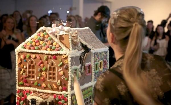 The Gingerbread Demolition lets people destroy gingerbread houses for charity.