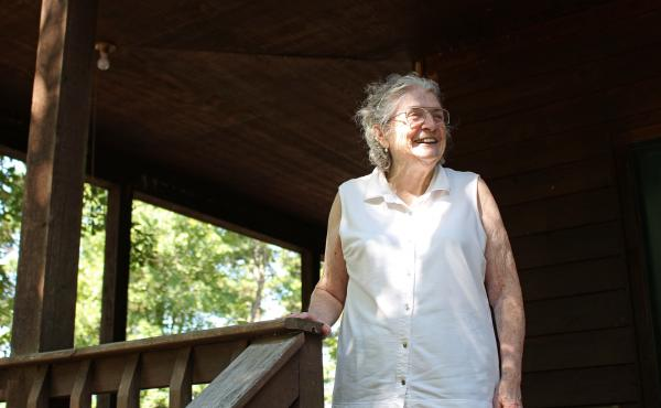 "Lulabelle Berry surveys the 600 acres she and her husband, Jimmy, own in the Ozarks near Mountain View, Ark. Berry walks laps on her porch to aid her recovery from a stroke. She says she's grateful for the drug that saved her life. ""It's been a good life,"