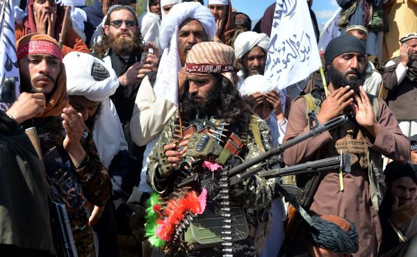 Afghan Taliban militants and villagers celebrate a peace deal and victory in March. News reports allege Russia offered bounties to Taliban-linked militants to kill U.S. troops. Russia accuses U.S. intelligence of leaking the story to scuttle the peace pro