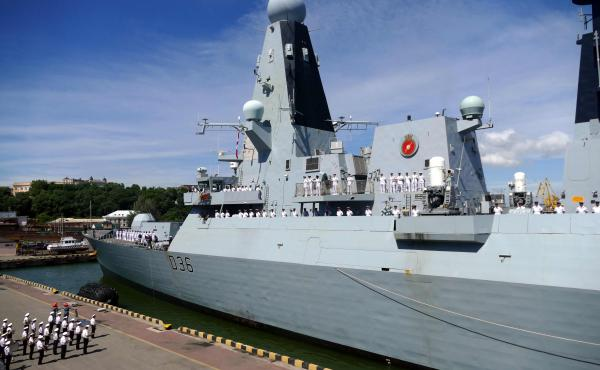 The British Royal Navy destroyer HMS Defender in the port of Odessa, Ukraine, on Tuesday. Russia said it fired warning shots at the warship Wednesday when it entered territorial waters off Crimea.
