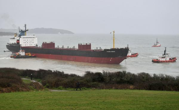 The Kuzma Minin was grounded Tuesday morning a few hundred feet from a British beach. Smaller boats were eventually able to help pull it free.