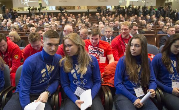 """Russian short track athletes, first row, and ice hockey players wearing sweatshirts with the words """"Russia is in my heart"""" attend a Russian Olympic Committee meeting  Tuesday. The Russian committee said it will support athletes who compete at the 2018 Win"""