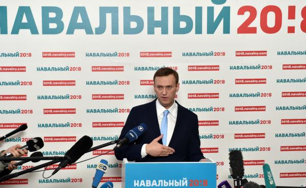 Russian opposition leader Alexei Navalny delivers a speech during a meeting with his supporters in Moscow on Sunday. Navalny, seen as the only Russian opposition leader who stands a fighting chance of challenging strongman Vladimir Putin, was seeking to g