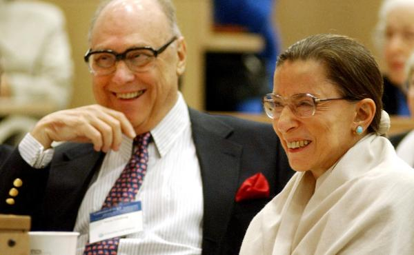 """Justice Ruth Bader Ginsburg shares laugh with her husband, Martin, at an event at Columbia Law School in 2003. Martin Ginsburg, or """"Marty,"""" passed away in 2010."""