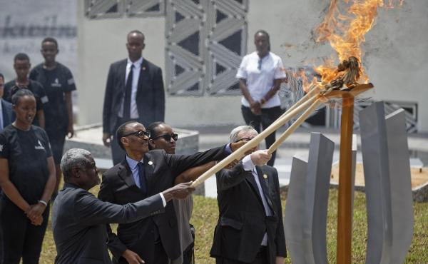 African Union Commission Chairperson Moussa Faki Mahamat (from left), Rwandan President Paul Kagame, Rwandan first lady Jeannette Kagame and European Commission President Jean-Claude Juncker light the flame of remembrance at the Kigali Genocide Memorial i