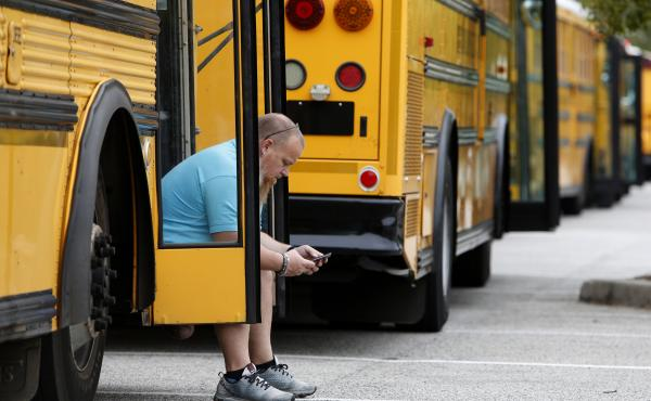 Jay McAbee, a bus driver with the Greenville, S.C., school district, waits by his bus in Charleston, S.C., in October of 2016, for word of when to start evacuating the city's residents in advance of Hurricane Matthew. Simply having enough buses to carry p