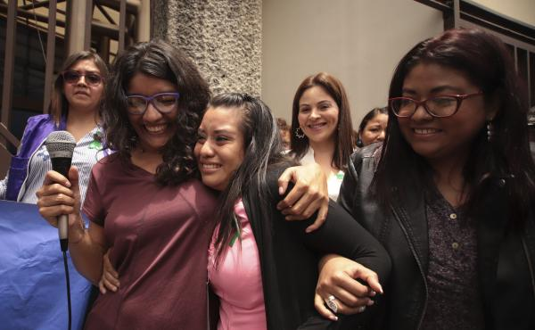 Evelyn Hernández (center) is embraced by supporters after she was acquitted of aggravated homicide in her retrial related to the loss of a pregnancy.