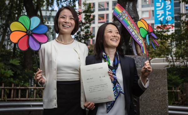 In this 2015 photo, Koyuki Higashi (left) and Hiroko Masuhara celebrate and hold up their same-sex marriage certificate in Tokyo. Today 13 gay couples filed a lawsuit arguing the country's general rejection of same-sex marriage rights violates the constit
