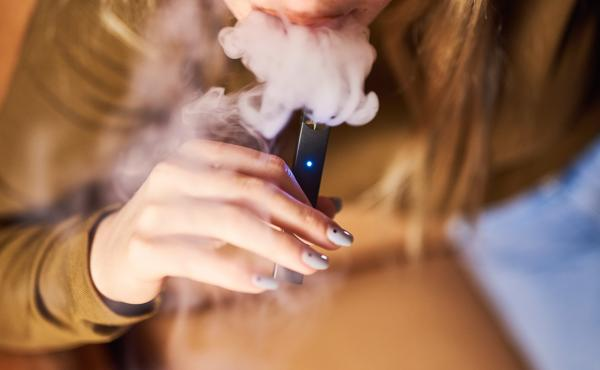 A person smokes a Juul Labs Inc. e-cigarette in a photograph taken in New York, last year.