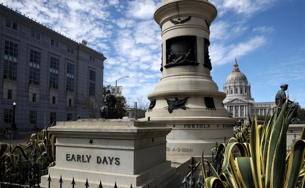 An empty pedestal remains where a statue known as Early Days, which depicted a Native American at the feet of a Catholic missionary and Spanish cowboy, used to stand on Fulton Street in San Francisco. The statue was removed early Friday morning.
