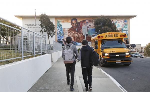 Students head toward Thurgood Marshall Academic High School in San Francisco in March.