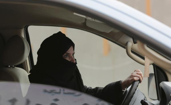 Saudi activist Aziza al-Yousef was arrested this week, along with other women's activists. In this March 29, 2014 photo, she drives a car on a highway in Riyadh as part of a campaign to defy Saudi Arabia's ban on women driving.