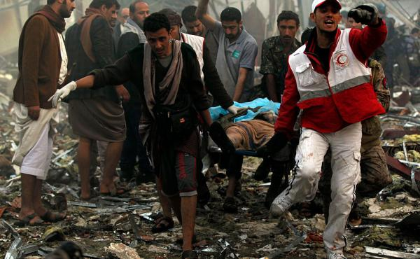 Yemeni rescue workers carry a victim on a stretcher amid the rubble of a destroyed funeral hall building following airstrikes by Saudi-led coalition planes on the capital Sanaa last Saturday.