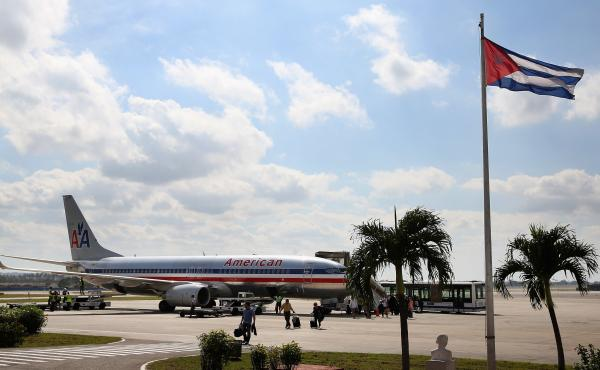 Passengers walk across the tarmac at Jose Marti International Airport after arriving on a charter plane operated by American Airlines January 19, 2015, in Havana, Cuba. The Department of Transportation has approved scheduled flights from the U.S. to Cuba,