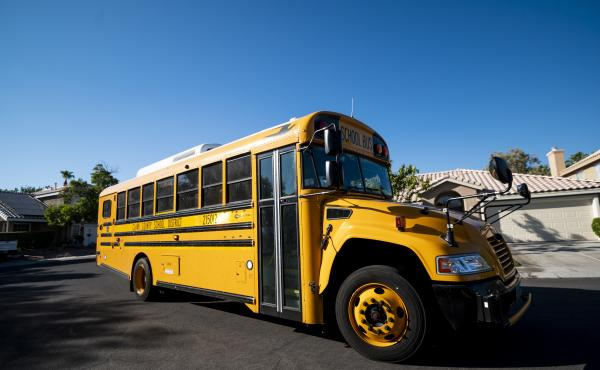 A Clark County, Nev., School District school bus drives through a Summerlin neighborhood last month. The National School Boards Association included an incident from Clark County in its letter to President Biden.