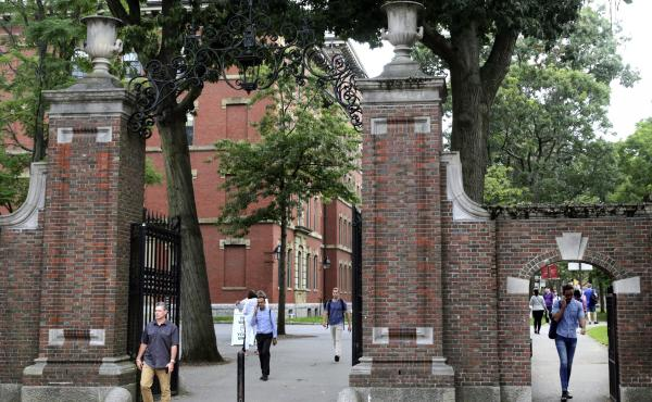Pedestrians in Harvard Yard in 2019. Schools and businesses have gone to court to stop the Trump administration from barring online-only international students from entering or staying in the United States.