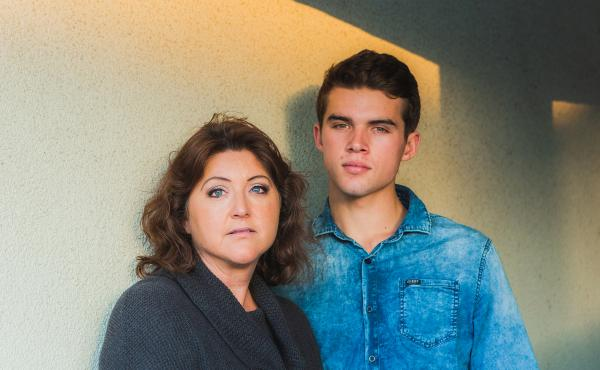 Connor Webb and his mother, Kim Webb, stand outside of their home in Huntington Beach, Calif. Connor was treated for a rare cancer at 16. He's well now but his mother is fighting for new cures in case the cancer comes back.
