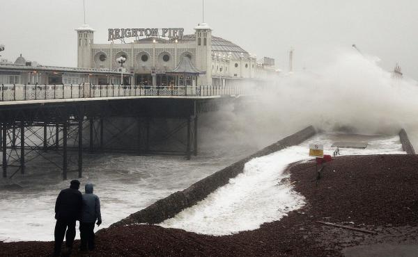 Waves crash onto the beach near Brighton Pier in England, in January 2007. Gale force winds and heavy rain brought disruption to large parts of the country. Severe weather events like this one may be linked to more frequent fluctuations in the polar jet s
