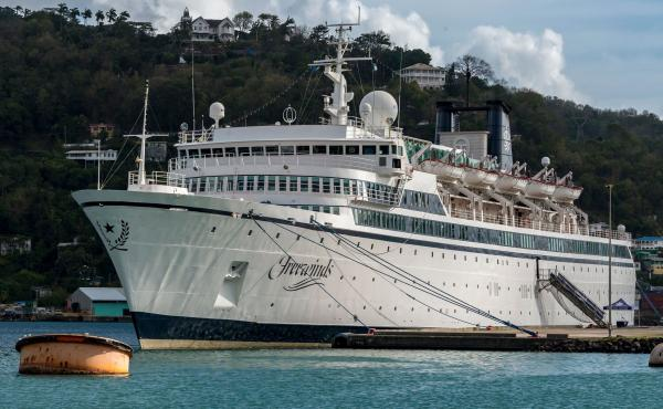 The Freewinds, a cruise ship owned by the Church of Scientology, is seen docked in quarantine in Castries, St. Lucia, on Thursday. The ship is now headed to the island of Curaçao, site of its home port.