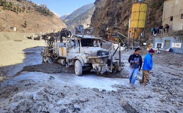 After a portion of the Nanda Devi glacier broke off in northern India on Sunday, people inspect a site near a damaged hydropower project at Reni village in Chamoli district in the country's Uttarakhand state.