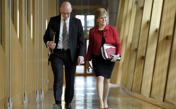 Scottish First Minister Nicola Sturgeon and Deputy First Minister John Swinney arrive at Scottish Parliament on Tuesday. They attended the second day of debate on a motion that ultimately granted Sturgeon the authority to pursue an independence referendum