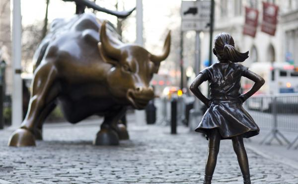 The Charging Bull and Fearless Girl square off in New York City's financial district. Arturo Di Modica, the bull's sculptor, says the girl staring it down has changed the meaning of his work in an unwelcome way.