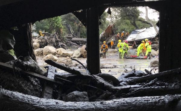 Santa Barbara County Fire Department firefighters respond to mud and debris flow due to heavy rain in Montecito.