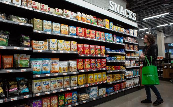 A pre-pandemic Seattle supermarket boasts row after row of prepackaged snacks. Even before the pandemic put extra stress on grocery workers, keeping shelves stocked with the variety Americans have come to expect took a hidden toll on producers, distributo
