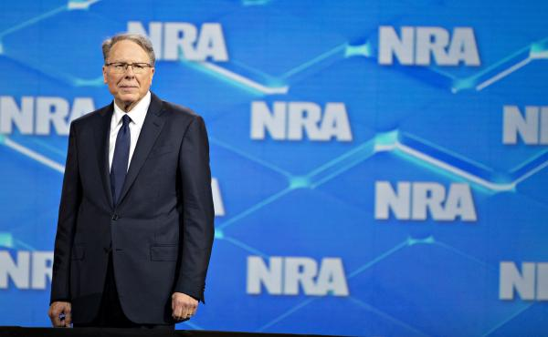 Wayne LaPierre, CEO of the National Rifle Association, stands onstage during the NRA's annual meeting in Indianapolis on April 26, 2019.